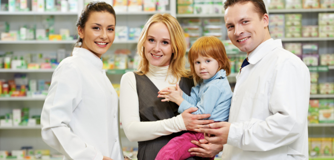 two pharmacist with mother and child